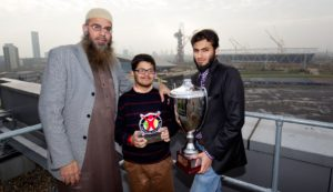 Faizan (centre) with his father and brother in front of the Olympic Park