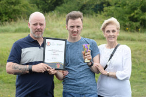 Thomas pictured with parents David and Melanie Ringrose